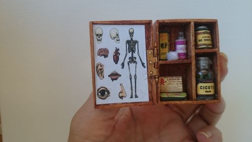 AC126-Small wooden cupboard with medicines